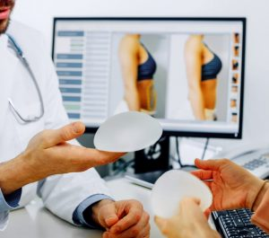 BREAST IMPLANT INJURIES AND BACK TO COMPETITIVE STANDARD.